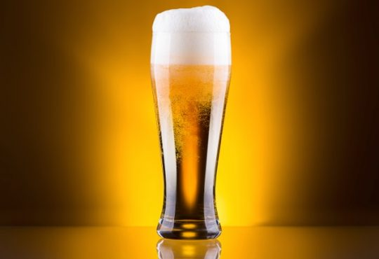 Glass of Beer Gold background